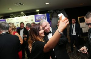 Last years host Eamonn Homles takes a selfie at the 2015 Neighbourhood Retailer Awards