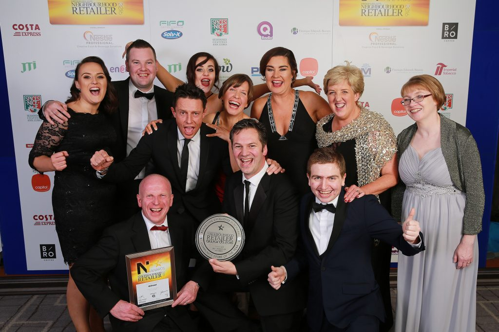 Jonathon Crawford (centre) is pictured with DJ Stephen Clements (left of centre) and the Crawfords of Maghera staff after winner the first Community Store of the Year award.